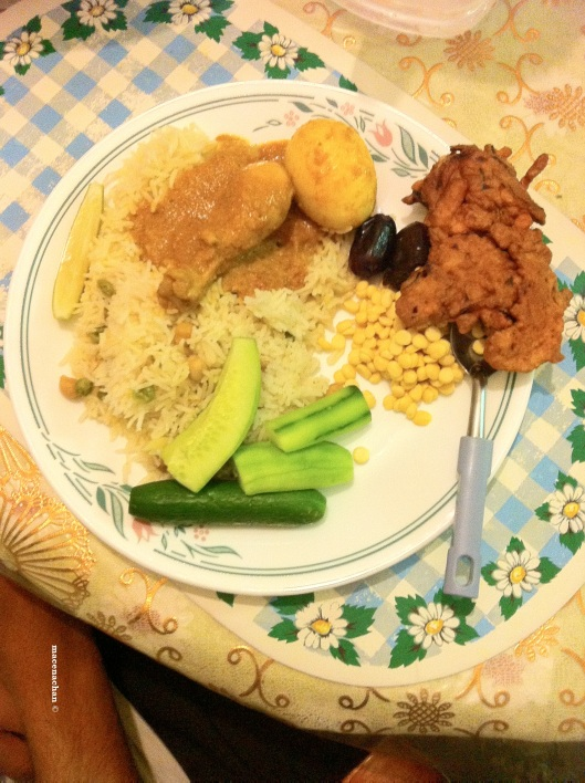 Day 3's Meal: Pakura, Pillaow rice, chicken curry, a boiled and curryfied egg, some dates and cucumber