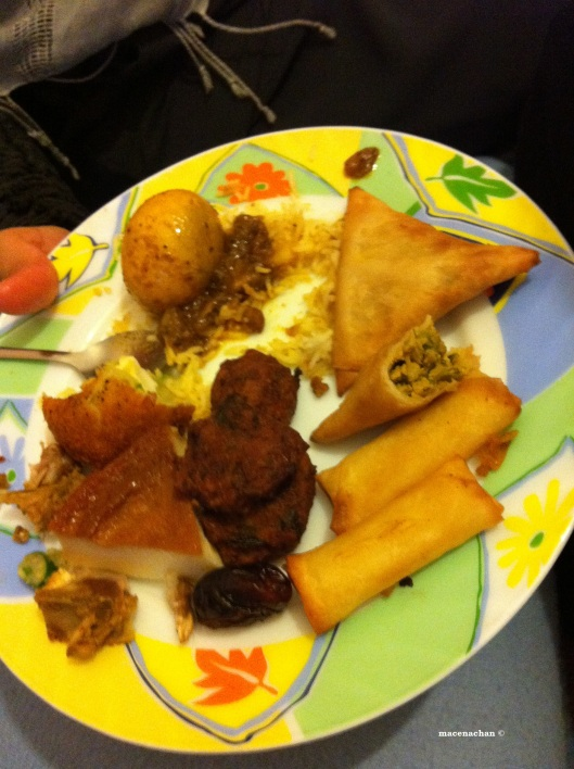 Day 20 My iftaar. There's a lot going on there. Samosa, cheese rolls, daal pakura, biryani, and a slice of egg pudding