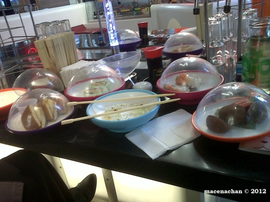 © 2012 Our YO Sushi table. The waiters were stunned with how many bowls we had