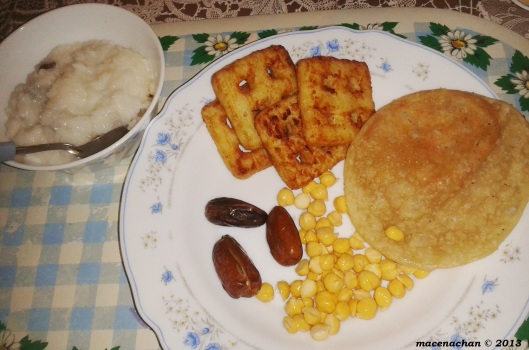 There's salted chickpeas, daal (lentil) puri, hash browns, dates and rice pudding with coconut and raisins
