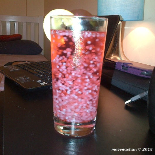 Rose syrup drink: The white balls you see floating are basil seeds. I'll be putting up the recipe to this really simple 'n' quick beverage soon!